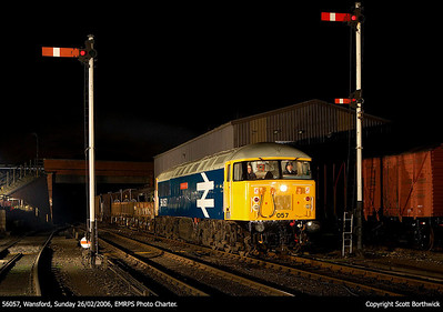 Almost ready to go, the headlight on 56057 is switched on as the train awaits entry to Wansford station with a ballast train on 26/02/2006.