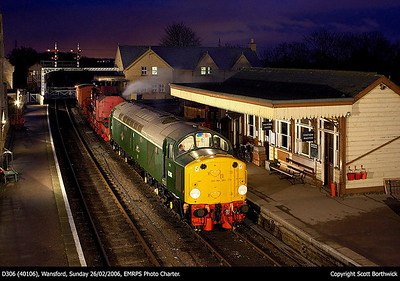 The crew oblige and switch on the cab lights, whilst the crane steams away merrily as D306 (40106) stands at Wansford on 26/02/2006.