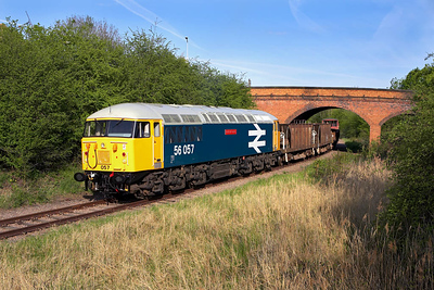 56057 is pictured passing under the London Road at Fletton during an EMRPS Photo Charter on 28/04/2006.
