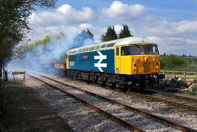 56057 makes a characteristically smokey departure from Yarwell Mill on 28/04/2006.