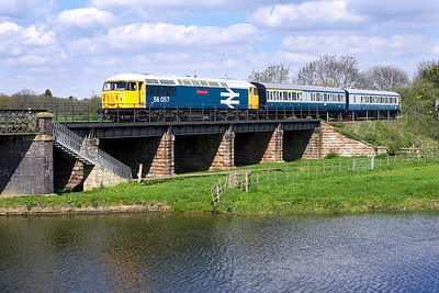 Resembling a DMU drag during the 1980's, 56057 drags DMU vehicles 59508 & 51347 across the River Nene at Wansford on 28/04/2006.