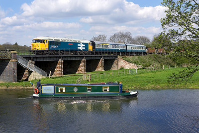 56057 awaits entry into Wansford station on 28/04/2006 as 'Ballinruan' heads east on the River Nene.