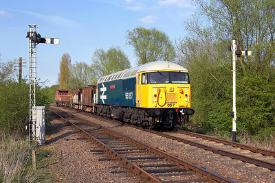 56057 comes off the Fletton Branch at Orton Mere on 28/04/2006 with a short ballast/spoil train.