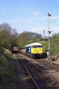 56057 is pictured in Wansford Cutting on a short ballast/spoil train during the EMRPS Photo Charter of 28/04/2006.