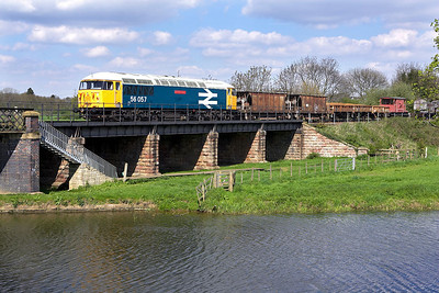 56057 crosses the River Nene at Wansford with its short ballast/spoil train on 28/04/2006.