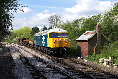 56057 stands at Yarwell Mill on 28/04/2006 with a short ballast/spoil train.