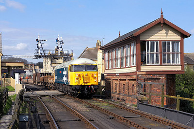 56057 departs from Wansford with a short ballast/spoil train on 28/04/2006.