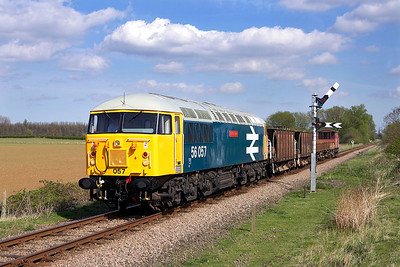 56057 approaches Sutton Cross with a short ballast/spoil train on 28/04/2006.