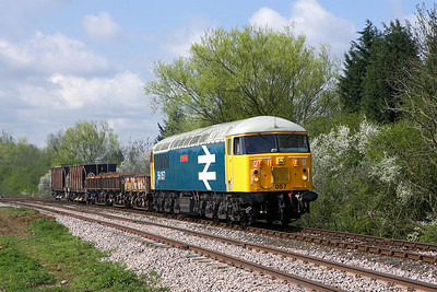 56057 stands on a short ballast/spoil train at Yarwell Mill on 28/04/2006.