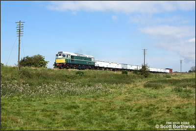 D5401 (27056) approaches Quorn & Woodhouse with the 'Windcutter' rake of open mineral wagons during an EMRPS photo charter on 04/09/2007.