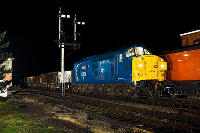 37324 stands alongside Toddington SB with a ballast train on a very wet 15/03/2008.
