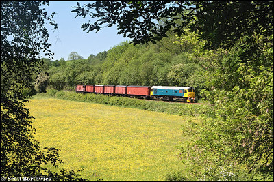 25322 'Tamworth Castle' heads a short rake of vans at Dustystile on 01/06/2009.