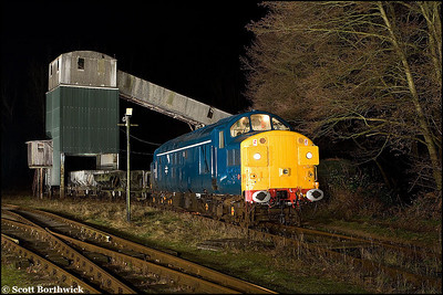 37075 stands under the former British Industrial Sand loading bunker at Oakamoor on 03/01/2009.