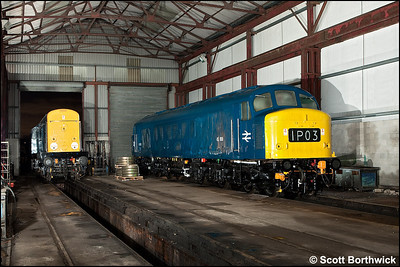 45108 stands inside the shed at Swanwick TMD as 20048 moves cautiously alongside on 12/12/2009.