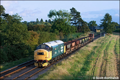 As the sun sets, 37314 'Dalzell' heads for Loughborough Central as it passes Woodhouse with a rake of empty ballast hoppers from Leicester North on 14/09/2009.