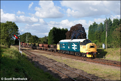 37314 'Dalzell' arrives at Quorn & Woodhouse with a rake of empty ballast hoppers for Leicester North on 14/09/2009.