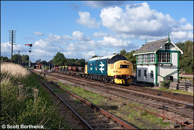 37314 'Dalzell' departs from Quorn & Woodhouse with a rake of empty ballast hoppers for Leicester North on 14/09/2009.