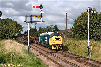 37314 'Dalzell' awaits the road at Loughborough Central's distant signal on 14/09/2009.