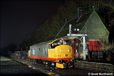 37152 stands at Darley Dale with a short ballast train on 27/02/2010.