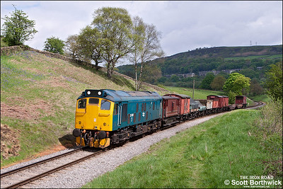 25059 hauls a short freight approaching Oakworth on 21/05/2013.