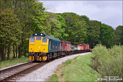 25059 hauls a short freight between Oakworth & Mytholmes on 21/05/2013.