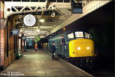 During a crew change, 45041 'Royal Tank Regiment' stands at Loughborough Central with a short ballast train on 29/09/2014.