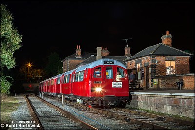 "A recreation of the final train out of Ongar, which ran on the 30th September 1994. ""The Silent Whistle"" headboard in the window is the original from that day. The ""Last Train Epping-Ongar"" headboard is a replica of the one used on the last train. 1960 stock driving motor 3906, 1938 stock trailer 4927 & 1960 stock driving motor 3907 await departure with the last train from Ongar to Epping on 27/09/2014."