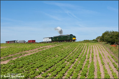 D6732 (37032) hauls the early morning mixed freight for Sheringham pictured shortly after departing from Weybourne on 12/06/2014.