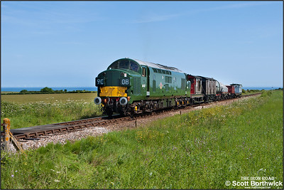 D6732 (37032) powers a Sheringham-Weybourne mixed freight approaching Weybourne's home signal on 12/06/2014.