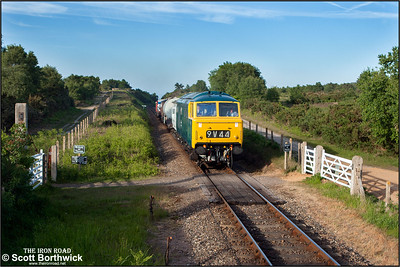 D7076 passes Kelling Heath crrossing whilst working a short mixed freight on 11/06/2015. (Photo taken with camera mounted on a pole & remotely triggered)