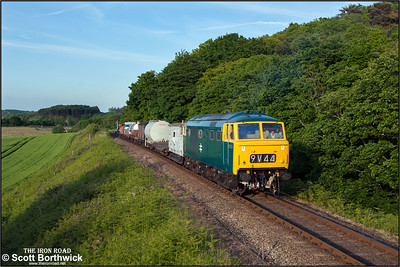 D7076 approaches Kelling Heath Halt whilst working a short mixed freight on 11/06/2015. (Photo taken with camera mounted on a pole & remotely triggered)