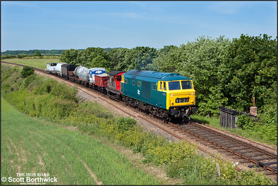 D7076 passes Dead Man's Hill with a short mixed freight on 11/06/2015. (Photo taken with camera mounted on a pole & remotely triggered)