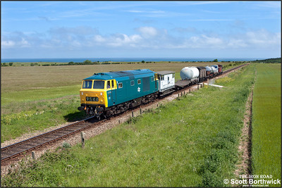 D7076 approaches Weybourne's home signal with a short mixed freight on 11/06/2015. (Photo taken with camera mounted on a pole & remotely triggered)
