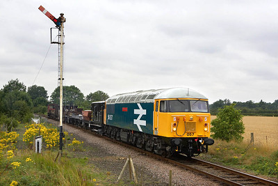 56057 is posed for the gallery at Sutton Cross after completing a couple of run pasts on 22/07/2005.