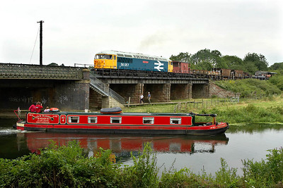 All eyes are on 56057 as it draws forward into Wansford station on 22/07/2005.