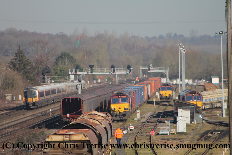 A busy scene at Eastleigh East Yard.  From left, Class 444 5 Car Desiro EMU Set number 444 032 is at the rear of 1W08 0903 Weymouth to London Waterloo which started from Wareham on this day.  Class 66 Diesel Locomotive number 66 169 is seen at the head of an intermodal working.  Class 66 Diesel Locomotive number 66 005 is seen light engine and finally Class 66 Diesel Locomotive number 66 011 is seen shunting a set of MRA wagons.<br /> 18th February 2015