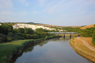 313201 working the 2C55 1825 Seaford to Brighton at Southerham crosses the River Ouse and passes the white chalk cliffs above the Cliffe Industrail estate on the 21st July 2018
