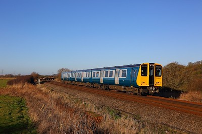 313201 on the 2F67 1340 Brighton to Seaford south of Southease on the 28th December 2017