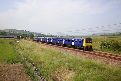 322481 on the 2S35 1434 Skipton to Bradford Forster Square at Cononley on the 29th June 2019