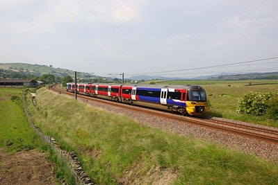 333006 on the 2H51 1517 Skipton to Leeds at Cononley on the 29th June 2019