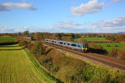 350402 on the 1M90 1509 Glasgow Central to Manchester Airport passes 350403 on the 1S66 1410 Manchester Airport to Edinburgh at Springfield, Gretna on the 6th October 2018