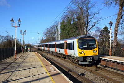 360203 on the 2Y12 0831 Heathrow Airport Terminal 4 to London Paddington at Hanwell on the 17th March 2019