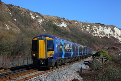 375819+375805 on the 2W38 1159 Dover Priory to London Charing Cross at Folkestone Warren Staff Halt (notice the old station staff shelter) on the 11th February 2018