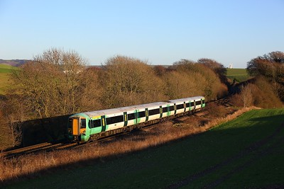377117 on the 2D20 1322 Ore to Brighton at Ashcombe Windmill, Kingston near Falmer on the 28th December 2017
