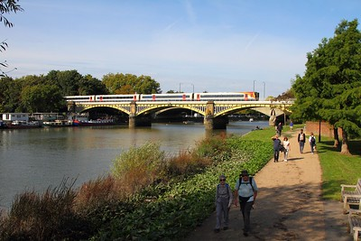 SWR 444 diverted via Staines and Twickenham because of engineering works between Clapham, Surbiton and Kingston  At Richmond Bridge with 1W28 0748 Weymouth to London Waterloo on 24 Sep 2017