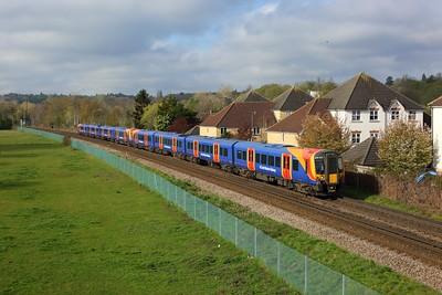450032 leading 450035 working 2S20 0833 Weybridge to London Waterloo at Egham on 16 April 2021  Class450, SWR, WaterlooReadingLine