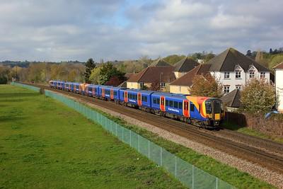 450126 leading 450040 on 2C20 0812 Reading to London Waterloo at Egham on 16 April 2021  Class450, SWR, WaterlooReadingLine