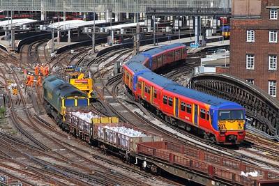 456014+456004+456017 on the 2J40 1406 Hampton Court to London Waterloo approaching London Waterloo and passing 66508 on the 2nd July 2017