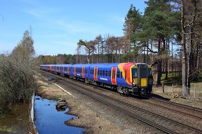 458510 leading 458528 working 2C36 1217 Wokingham to London Waterloo at Chobham Common on 17 April 2021  Class458, SWR, ReadingLondonLine