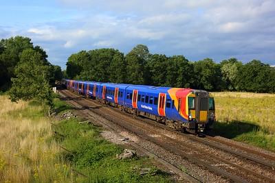 458520 leading 458528 working 2S51 1652 London Waterloo to Weybridge at Egham on 12 August 2021  Class458, SWR, WaterlooReadingLine